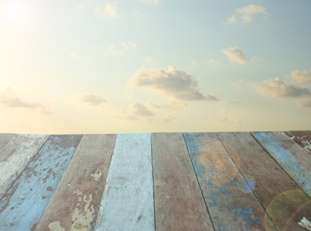 Grunge wooden floor with sunrise sky background photo