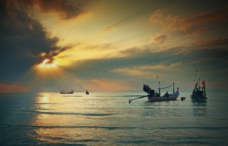 long tailed boat: Longtail boat in the sunrise over sea and blue sky