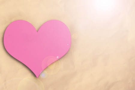 Pink heart on crumpled paper  background photo