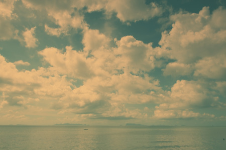 View of seascape witn big big white clouds in vintage style photo