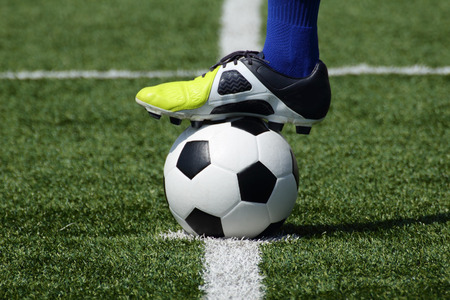 Soccer players feet on the ball photo