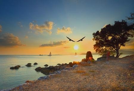 sailingboat: dramatic tropical sunset sky and sea at dusk with sailingboat
