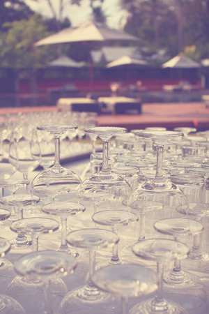 Wine glasses   arrange on table outdoors with vintage filter effect photo