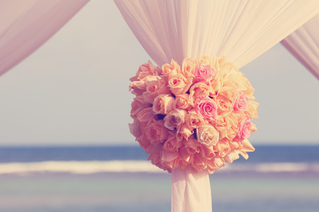Vintage roses bouquet arrange for wedding decoration with sea background photo