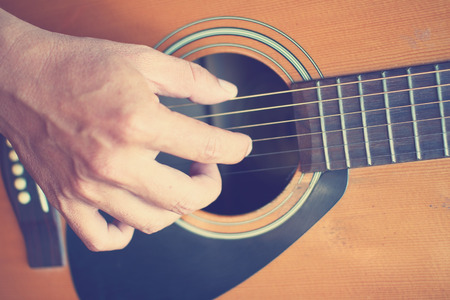 gutar: Guitarist plays guitar in vintage style Stock Photo