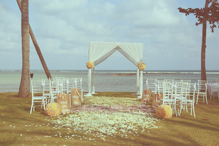 Vintage wedding arch set up on beach ,filtered image photo