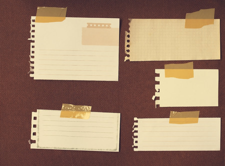 Note papers for message on grunge wood ,vintage filtered image photo