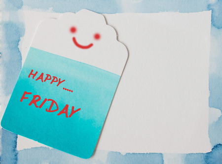 Happy Friday on blue watercolor frame and label paper  photo