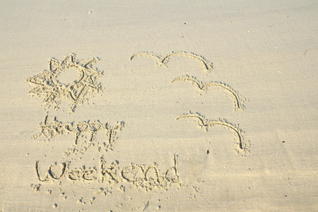 Happy weekend wrote on beach sand Stock Photo