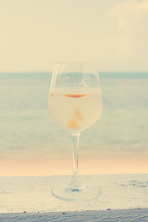 Margarita cocktail on beach with vintage filter effect photo