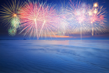 Colorful firework at the beach and blue sky