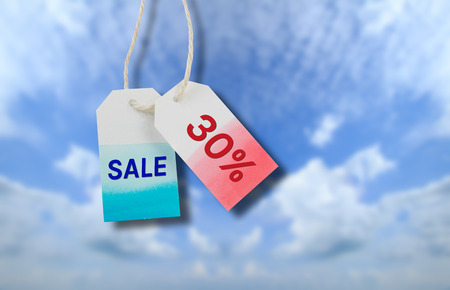 Sale price tag with cloud and blue sky background photo