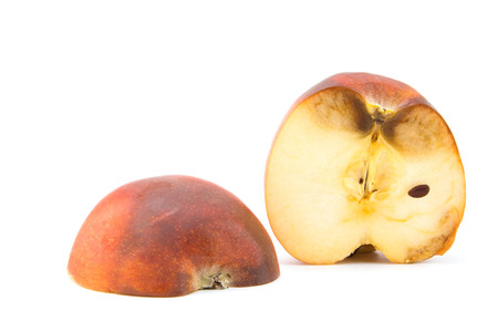 bruised: Rotten apple fruit  isolated on a white background