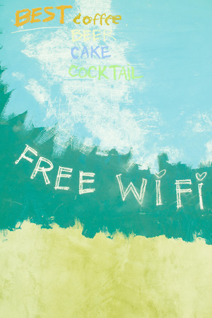 Free wifi sign on grunge blue background photo