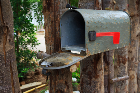 Old mailbox on wood fence outdoor photo