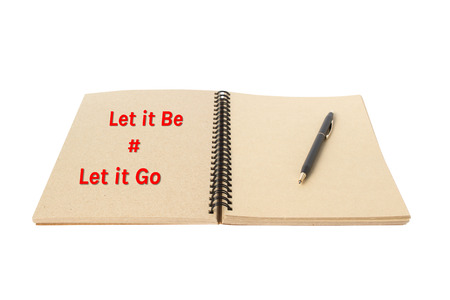Let it be word on open note book and pen isolated with path photo