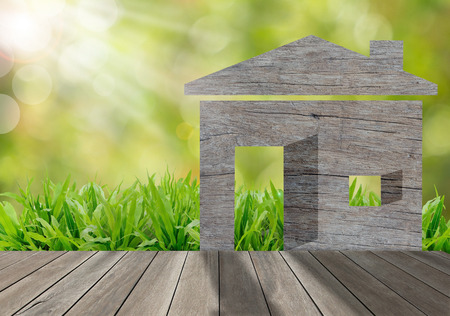 Wooden house on green grass field in morning sunlight,environment concept photo
