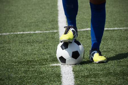 Soccer players feet on the ball Stock Photo