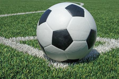 grass field: Soccer ball green grass field Stock Photo