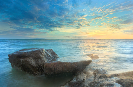 Seascape sunset with fantastic rock surface,Long exposure  photo