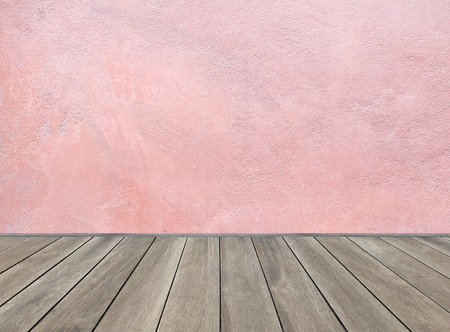 Wooden floor and pastel pink background photo
