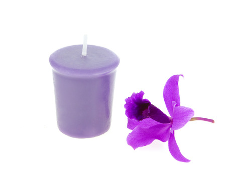 Spa and aroma therapy setting with orchid and candle isolated on white background photo