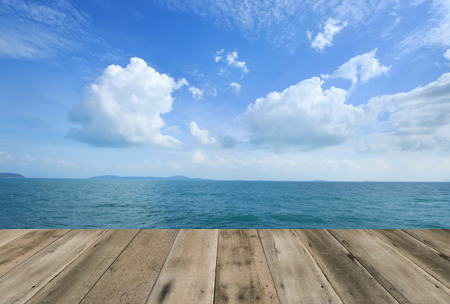 Wood floor with blue sea sky background Stock Photo