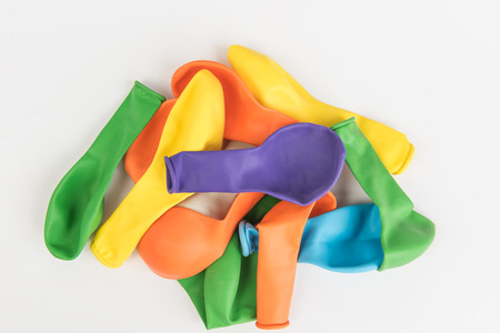 deflated: Colorful deflated balloons on white background
