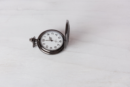 grune: Classic pocket watch on white grune wooden background