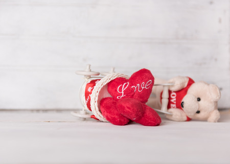 broken love: Broken love,Teddy bear and red hearts on grunge white wood background Stock Photo