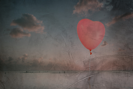 red sky: Grunge pink balloon over sea sky background with retro filter effect
