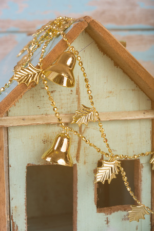jingle: Old vintage wood house decorative with Christmas jingle bell