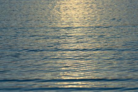 wavelet: Ripple wave texture at golden sunrise background