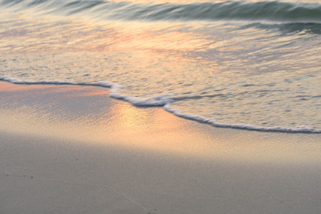 golden light: Golden light reflec on white sand beach background at dawn,retro effect Stock Photo