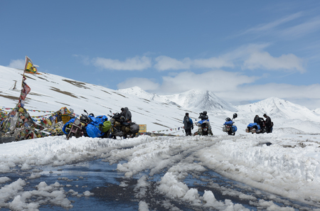 highroad: TANGLANG LA PASS, LADAKH , INDIA JULY 20, 2015: Tourists relaxing on the summit of the Tanglang La pass is the second highest motorable road in the world at 5400m Editorial