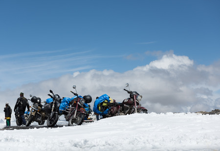 enfield: TANGLANG LA PASS, LADAKH , INDIA JULY 20, 2015: Tourists relaxing on the summit of the Tanglang La pass is the second highest motorable road in the world at 5400m Editorial