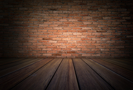 grunge room: Grunge room with wooden floor and red brick wall background