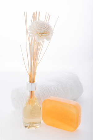 Spa aromatherapy products with essential oil and luffa soap  on white background