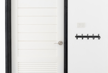 room door: White wooden door interior modern room with black hanger Stock Photo