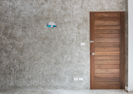 room door: Wooden door with retro lamp decoration in modern room interior Stock Photo