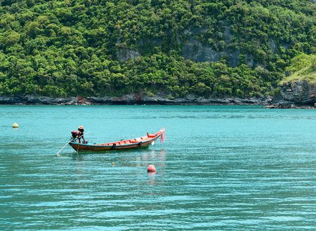 Long Tail Boat in Clear Water and Blue sky. Samui Island, Thailand. Stock Photo