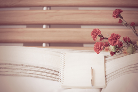 furniture: Flower decoration,note book and pencil in modern bathroom interior,retro filter Stock Photo