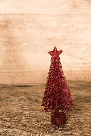 Christmas red pine tree stand on wooden table  background