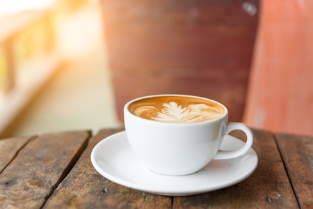 coffee cup Latte art on old vintage blue wood table outdoor with copy space for text Stock Photo