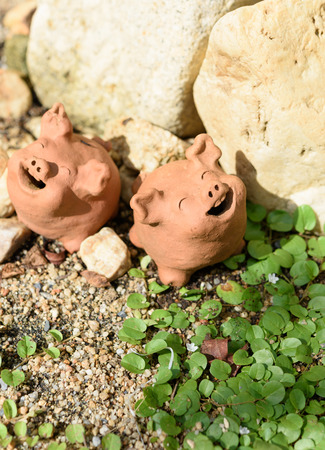 Piggy clay decorative in green garden outdoor,summer time Stock Photo