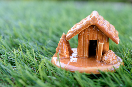 Miniature house building on green grass Stock Photo