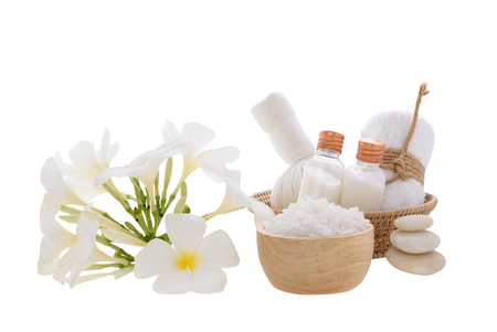 Spa and massage ball with essential oils,zen stone, towels and frangipani flowers on wooden tray isolated over white background with clipping path Stock Photo