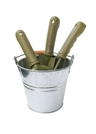 Green shovel gardening tools in galvanized potted  isolated on white background