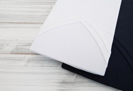 New black and white  v neck shirt on white wooden background