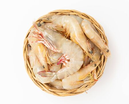 Raw fresh shrimps,prawns set in rattan bowl isolated on white background,top view